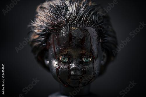 Fotografija Creepy bloody doll in the dark