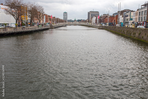 Fototapeta Liffey River and the Halfpenny Bridge, Dublin, Ireland