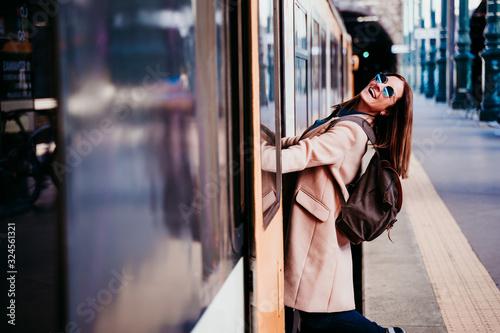 Fototapeta happy young woman at train station. Travel concept obraz