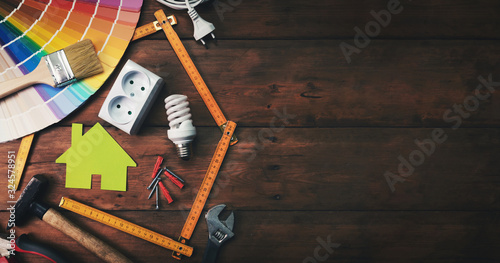 Fotomural home improvement and repair concept - construction tools and objects on wooden background