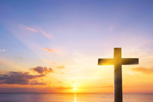 Silhouette Cross On  Sunset Background
