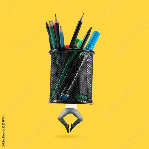 Fototapeta Man jumping high with big bunch of pen on yellow background. Copyspace for your proposal. Modern design. Contemporary artwork, collage. Concept of sport, office, hard work, dreams, business, action. obraz