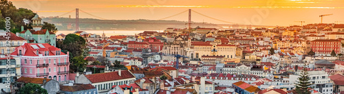A view of the Alfama downtown and the 25 April Bridge. - 324590190