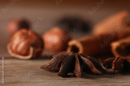 fragrant cinnamon sticks and star anise on a wooden surface Canvas Print