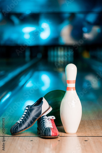 selective focus of bowling shoes, ball and skittle on bowling alley Fototapeta