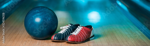 Fotografie, Tablou panoramic shot of bowling shoes and ball on skittle alley in bowling club