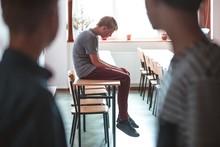 Sad Teenage Boy Sitting Alone ...