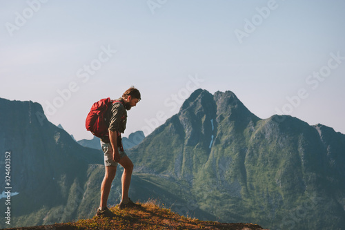 Obraz Man hiking in mountains travel backpacking summer vacations outdoor adventure trekking active healthy lifestyle in Norway - fototapety do salonu