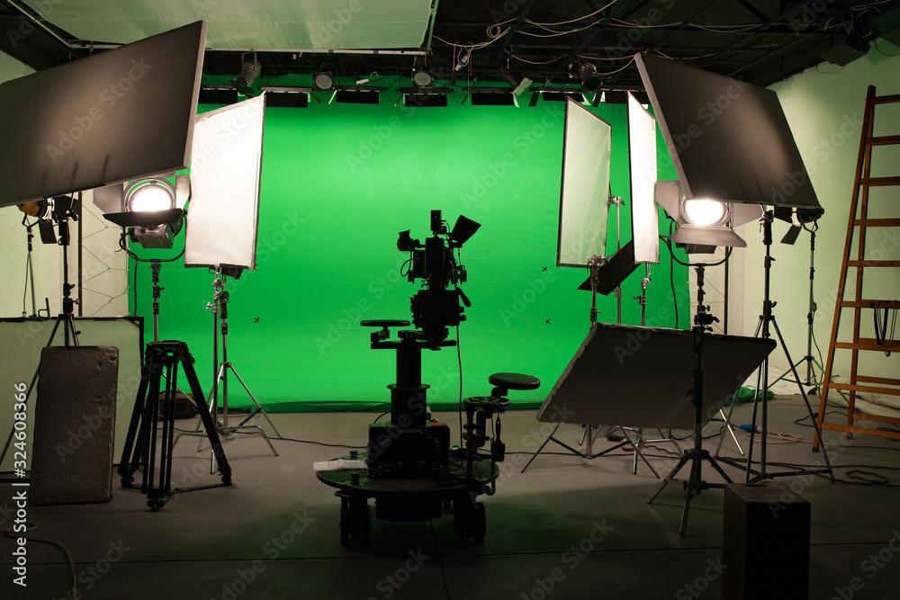 Fototapeta Shooting studio with professional equipment and green screen