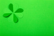 Leinwanddruck Bild - St. Patrick 's Day (St. Paddy's Day) background concept. Green clover from paper on a green background. Clover is a symbol of Ireland and Celtic culture