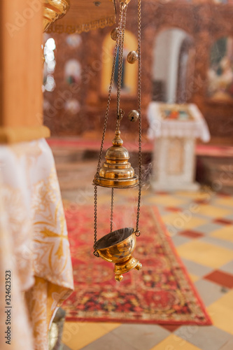 Photo A priest's censer hanging in the Orthodox Church