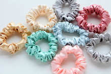 Lot Of Colorful Silk Scrunchies On White. Flat Lay Hairdressing Tools And Accessories. Hair Scrunchies, Elastic HairBands, Bobble Sports Scrunchie Hairband