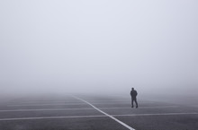 Man Walking Through Very Foggy...