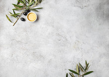 Food Background With Linen Napkin, Olive Tree Branch, Olive Oil On Concrete Background