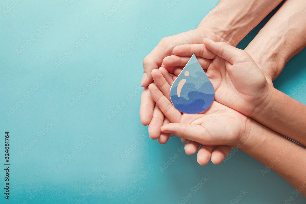 Fototapeta Adult and child hands holding water drop, World Water Day,  Clean water, sanitation, hand sanitizer and hygiene for coronavirus pandemic, family washing hands, CSR, save water,  ecology concept