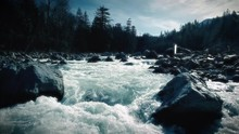 Aerial Flying Up River Rapids Stylized Slow Motion