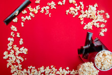 Flat Lay Composition With Popcorn And Film. Space For Text On Red Background. Cinema Concept