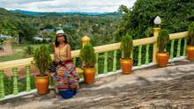 Woman Standing In Garden In Wat In Pak Nam Pran