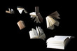 canvas print picture - Flying books isolated on black