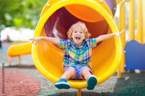 Child on playground. Kids play outdoor. Fototapete
