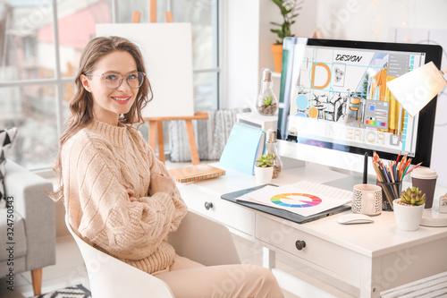 Female interior designer working in office Fototapet