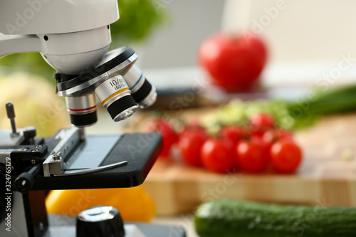 Papel de parede Microscope head on kitchen background vegetables concept nitrates