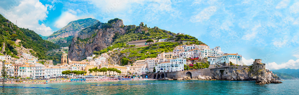 Fototapeta Panoramic view, aerial skyline of small haven of Amalfi village with tiny beach and colorful houses, located on rock, Amalfi coast, Salerno, Campania, Italy