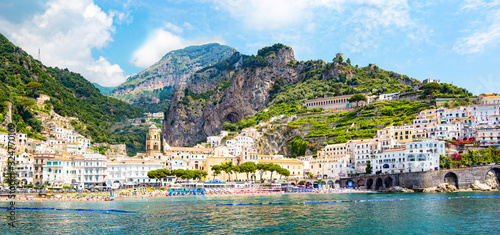 Panoramic view of small haven of Amalfi village with turquoise sea and colorful houses on slopes of Amalfi Coast with Gulf of Salerno, Campania, Italy Canvas Print