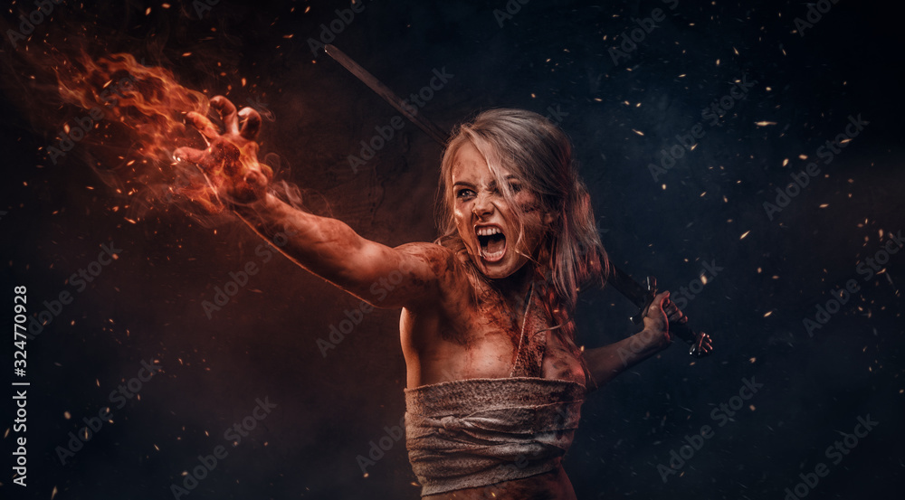 Fototapeta Fantasy woman warrior wearing rag cloth stained with blood and mud in the heat of battle. Cosplayer as Ciri from The Witcher
