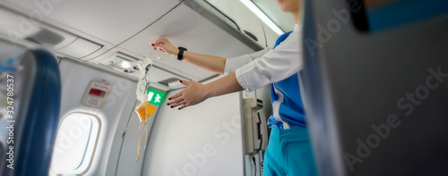Photo Aeroflot shows how to use an oxygen mask on board, Air hostess demonstrate safet