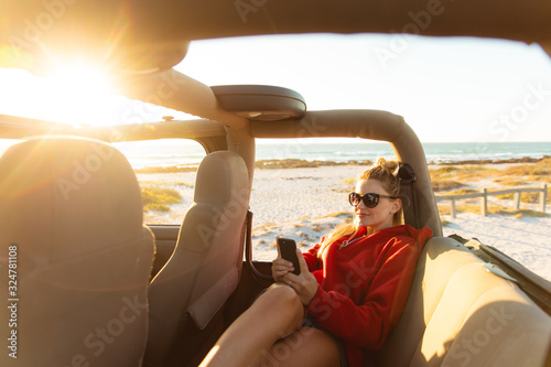 Woman with car enjoying free time