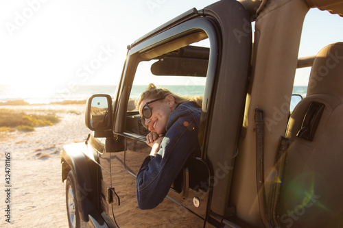 Woman in a car at the beach