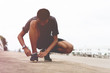 Tie a shoe,Asian male jogger athlete training and doing workout outdoors on a street, He tying laces for jogging on road with running shoes. Runner getting ready for exercise. Sport lifestyle concept