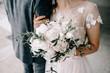 canvas print picture - wedding bouquet in bride's hands, david austin