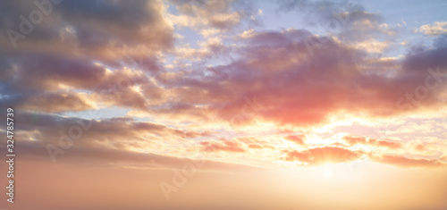 Fototapety, obrazy: Dramatic sunset background of orange and yellow clouds against a blue sky background.