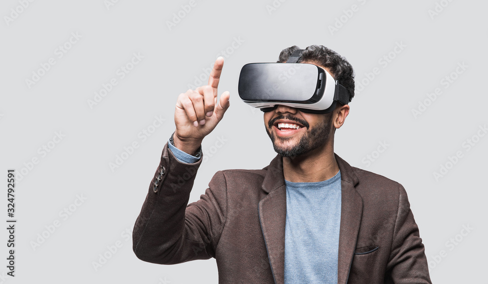 Fototapeta Young man using virtual reality headset, VR, future, gadgets, technology concept