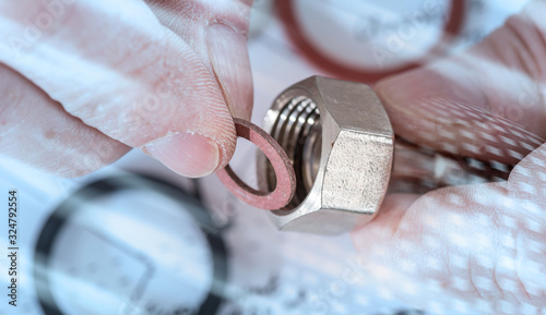 Fotomural Plumber putting a gasket on a plumbing fitting; light effect