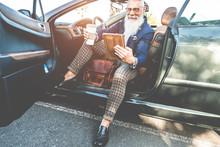 Hipster Stylish Man Using Tabl...