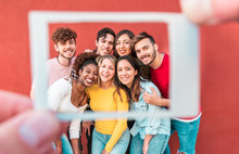 Happy Students Friends From Diverse Cultures Having Fun Doing Souvenir Photo With Photographic Instant Camera Paper  - Youth, Technology, Social Trends, Lifestyle And Friendship Concept