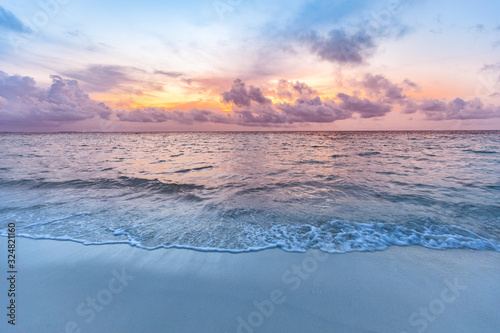 Fototapeta Sea sand sky concept, sunset colors clouds, horizon, horizontal background banner. Inspirational nature landscape, beautiful colors, wonderful scenery of tropical beach. Beach sunset, summer vacation obraz