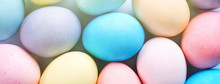 Colorful Easter Eggs Dyed By Colored Water With Beautiful Pattern On A Pale Blue Background, Design Concept Of Holiday Activity, Top View, Full Frame.
