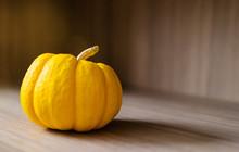 Small Yellow Pumpkin On Wooden...