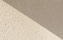 Background Of Light Concrete Wall With Shaddow.White Classic Texture For Designer Background. Rough Lighted Surface. Concrete Wall With Plaster. Light Concrete. Concrete Coat