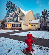 Beauiful House And Red Fire Hydrant On A Snowy Morning