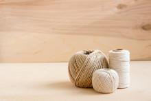 Beige Threads, Twine On Wooden Background