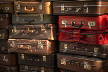 Aged Weathered Leather Suitcases On Top Of Eachother