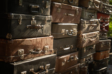 Vintage Weathered Leather Suitcases On Top Of Eachother