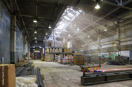 Fototapeta An empty production warehouse and industrial workshop obraz