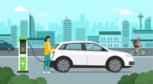 Woman Recharging Her Electric Car