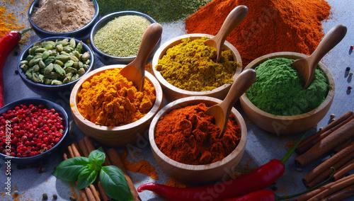 Fototapeta Variety of spices on kitchen table obraz